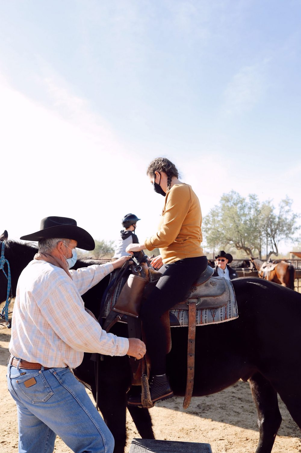 One of the Best Secret Winter Sun Destinations, Scottsdale Arizona. Horseback riding in the desert and family-friendly activities at MacDonald's Ranch. |Guide by popular Florida travel blog, Fresh Mommy Blog: image of a woman riding a horse.
