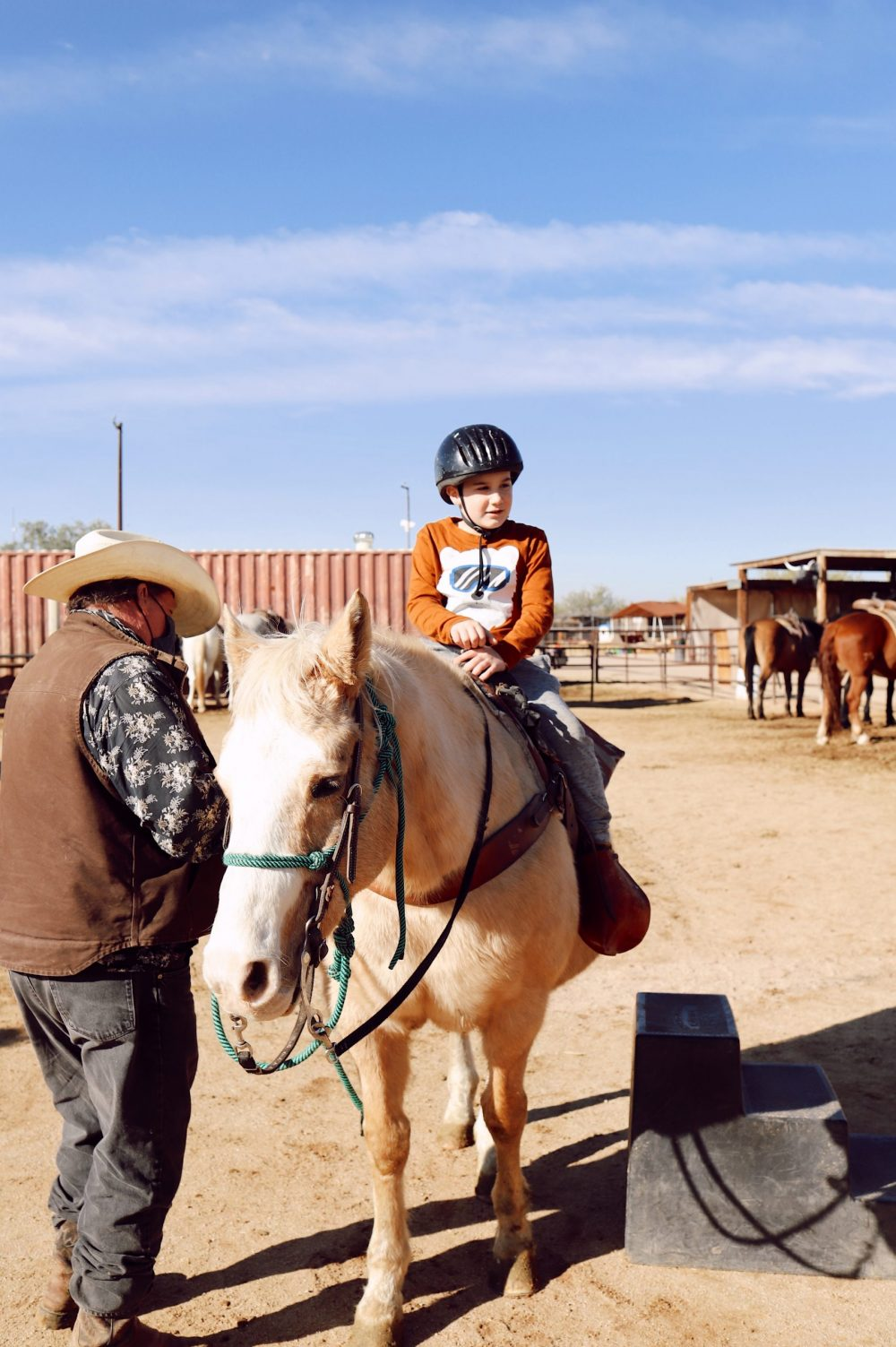 One of the Best Secret Winter Sun Destinations, Scottsdale Arizona. Horseback riding in the desert and family-friendly activities at MacDonald's Ranch. |Guide by popular Florida travel blog, Fresh Mommy Blog: image of a little boy riding a horse.