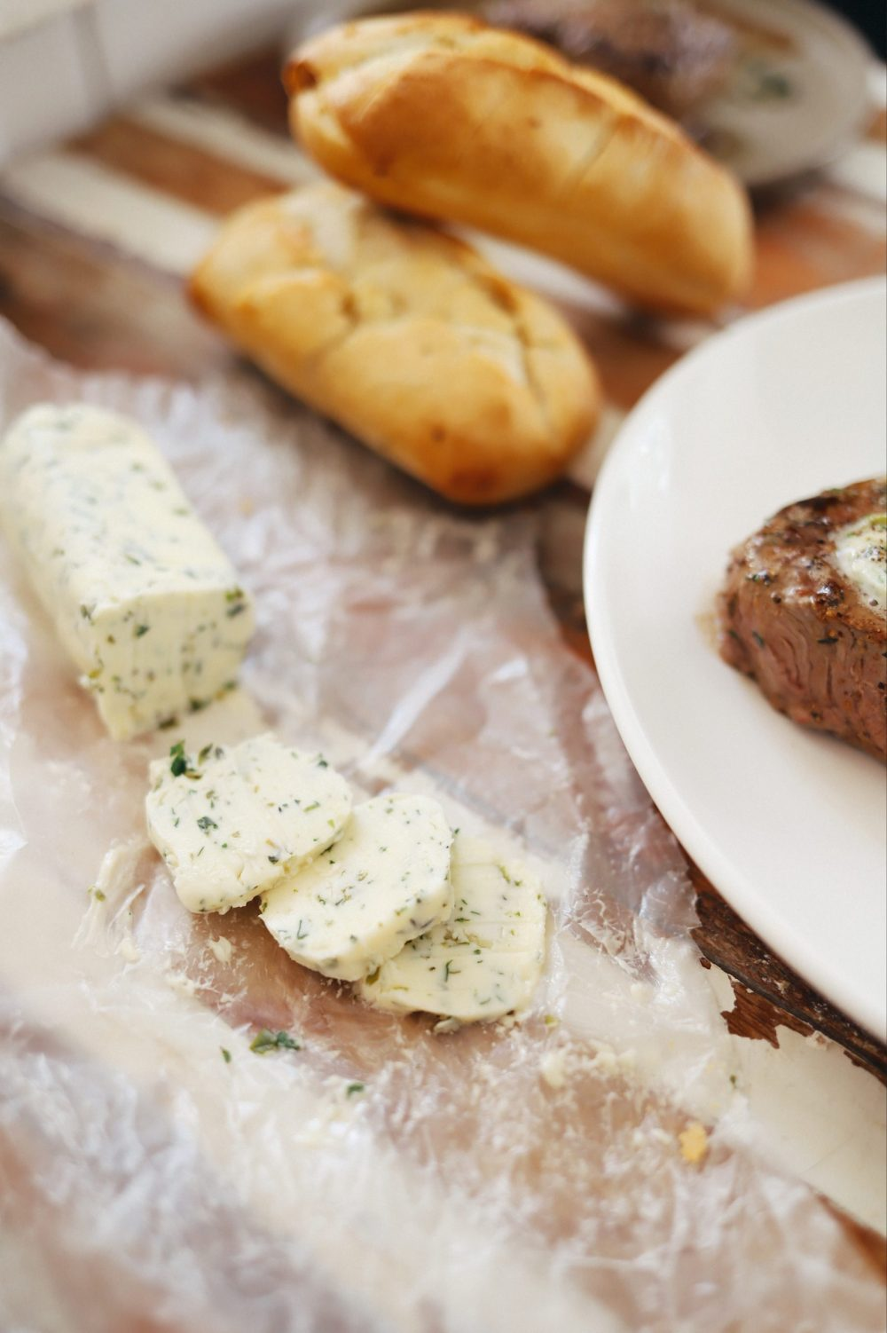 Homemade Steak Butter: How to Make an Easy Steakhouse Herb Butter for Steak  Steak Butter by popular Florida lifestyle blog, Fresh Mommy Blog: image of herb butter on some wax paper.