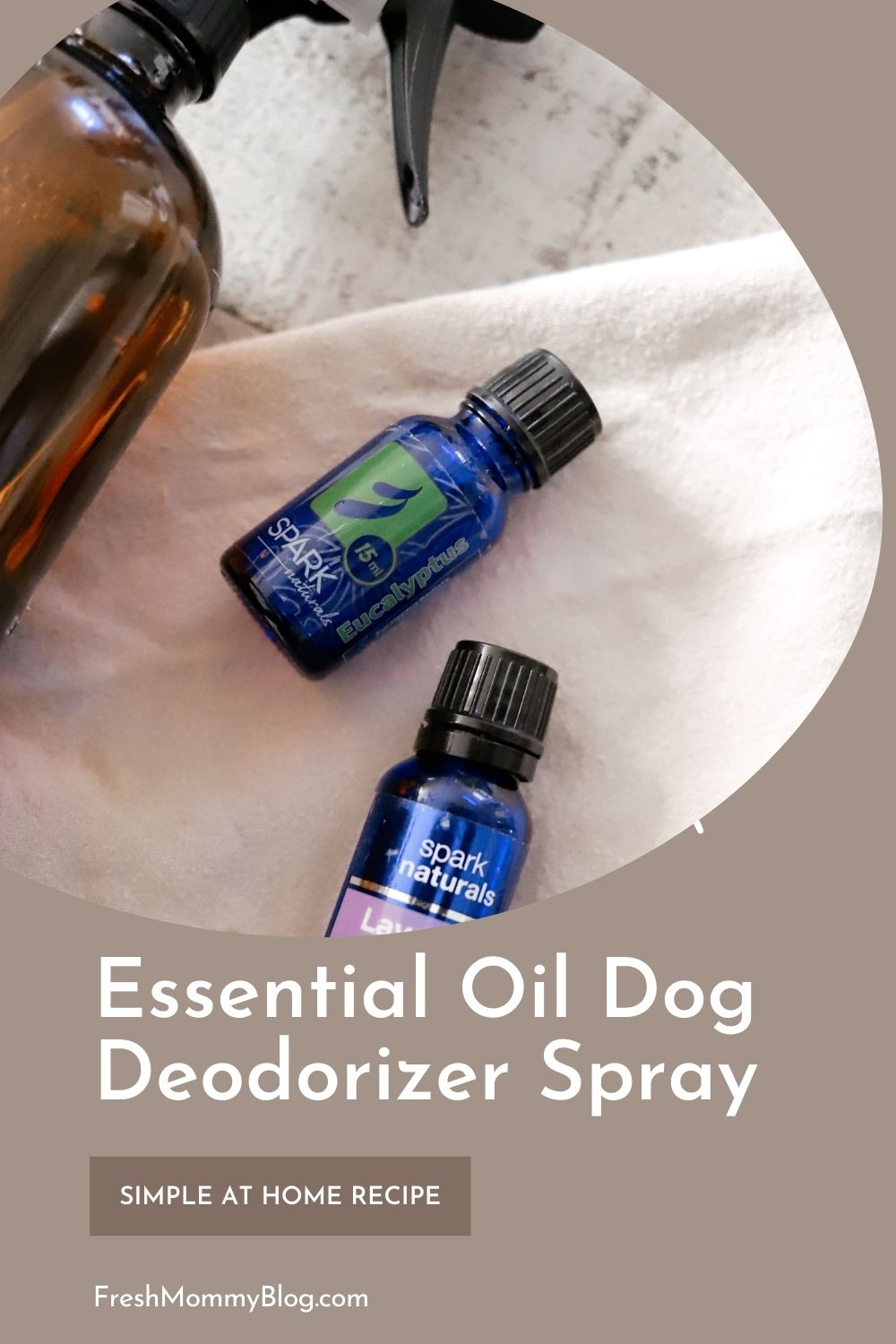 Essential Oils Safe for Dog Deodorizer Spray |Dog Deodorizer Spray by popular Florida lifestyle blog, Fresh Mommy Blog: Pinterest image of a glass amber spray bottle lying next to a bottle of Spark Naturals eucalyptus oil and Spark Naturals Lavender oil.