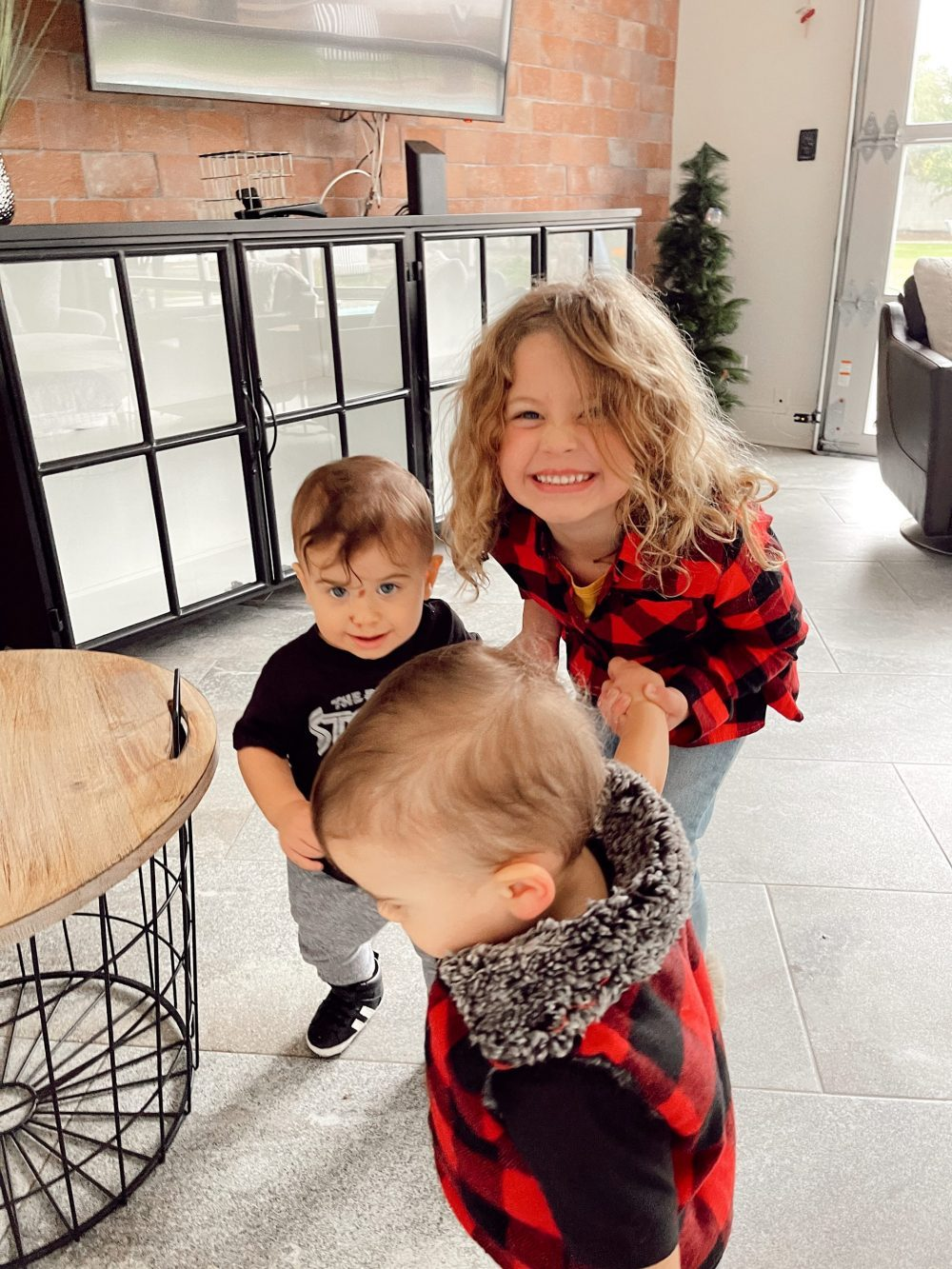 One of the Best Secret Winter Sun Destinations, Scottsdale Arizona. Family-friendly property rental at Bella's Villa Voltaire |Guide by popular Florida travel blog, Fresh Mommy Blog: image of three young kids playing together.