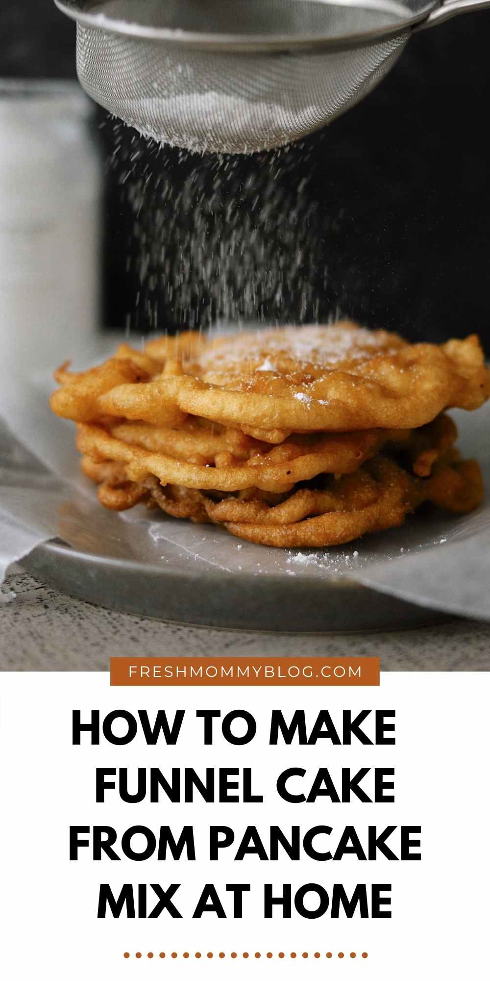 How to Make Yummy Funnel Cake From Pancake Mix at Home   Pancake Mix Funnel Cake, by popular Florida lifestyle blog, Fresh Mommy Blog: image of a woman putting powdered sugar on some pancake mix funnel cakes.