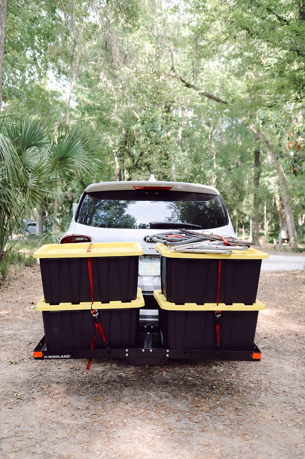11 Camping Must Haves and Don't Bothers You Need to Know Before You Go. Family Camping - how to pack it all for camping   Camping Must Haves by popular Florida lifestyle blog, Fresh Mommy Blog: image of black and yellow plastic storage boxes on the back of a car.