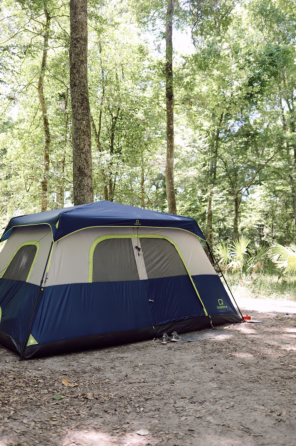 11 Camping Must Haves and Don't Bothers You Need to Know Before You Go. Family Camping   Camping Must Haves by popular Florida lifestyle blog, Fresh Mommy Blog: image of a blue and grey tent.