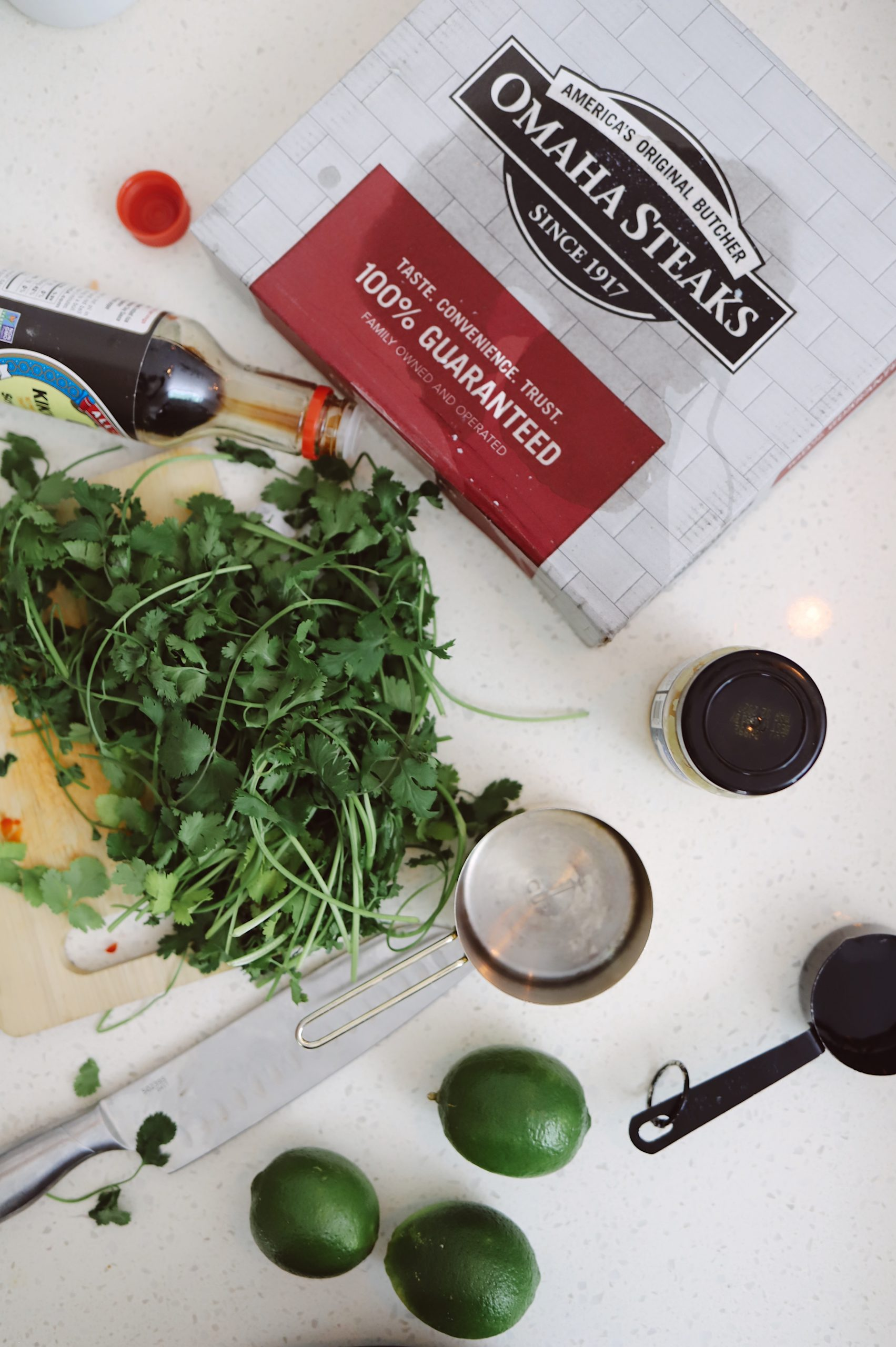 Slow Cooker Thai Chicken with Peanut Sauce recipe from Tabitha Blue of Fresh Mommy Blog   Slow Cooker Thai Chicken by popular Florida lifestyle blog, Fresh Mommy Blog: image of cilantro, soy sauce and a Omaha Steaks box.
