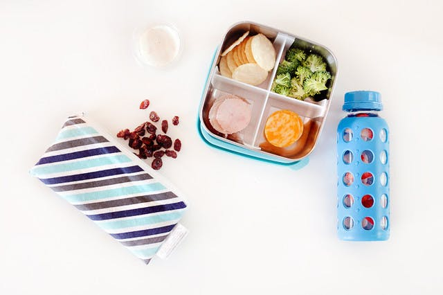 Five lunchbox lunchable hacks that are easy to put together, packed full of nutrients to fuel their school day and can absolutely be made ahead of time so the morning of is still as easy as reaching in the refrigerator. | Healthy Lunchables by popular Florida lifestyle blog, Fresh Mommy Blog: image of a metal bento box filled with deli meat, cheese slices, crackers, and broccoli.