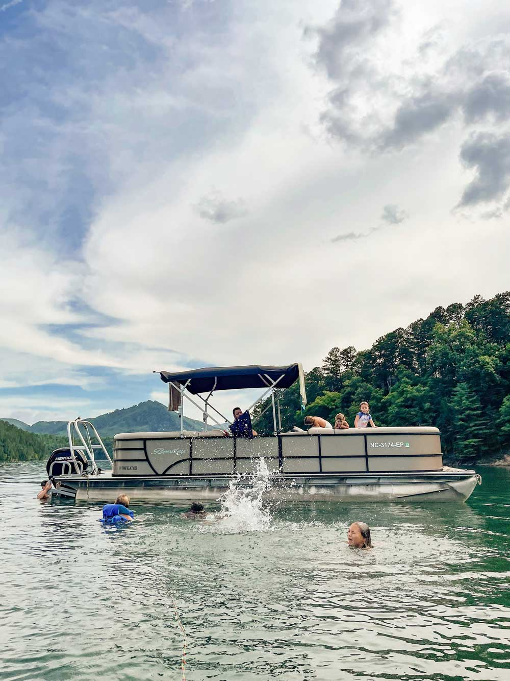 Best Things to Do in Bryson City NC with Kids - Boating on Lake Fontana   Things to do in Bryson City NC by popular Florida travel blog, Fresh Mommy Blog: image of family boating on Lake Fontana.