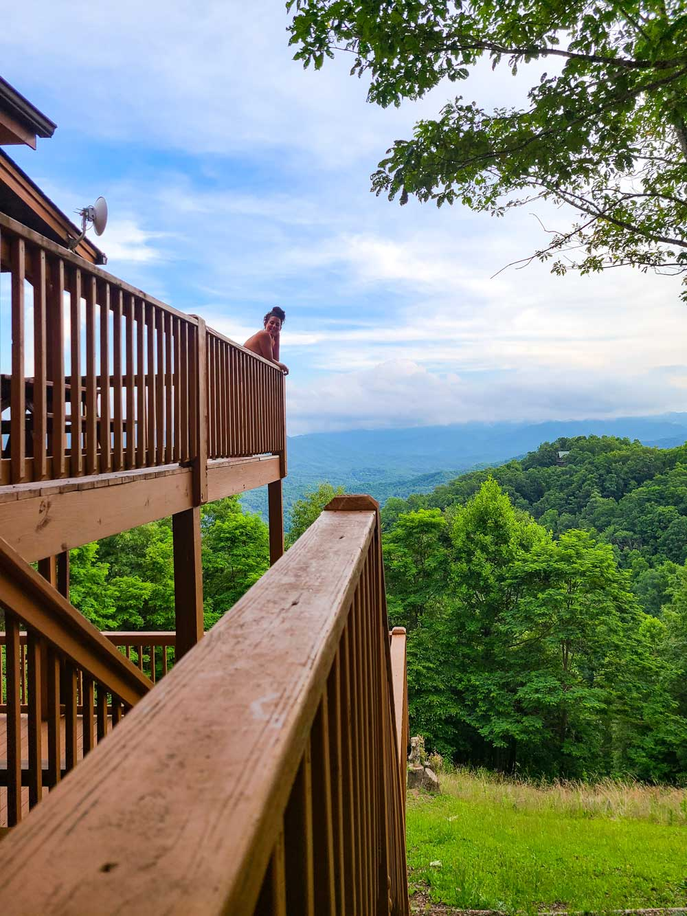 Best Things to Do in Bryson City NC with Kids   Things to do in Bryson City NC by popular Florida travel blog, Fresh Mommy Blog: image of a woman standing on a cabin deck.