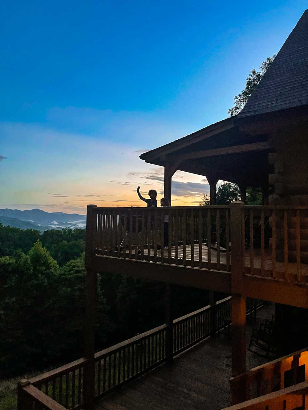 Best Things to Do in Bryson City NC with Kids   Things to do in Bryson City NC by popular Florida travel blog, Fresh Mommy Blog: image of some boys standing outside on a cabin deck.