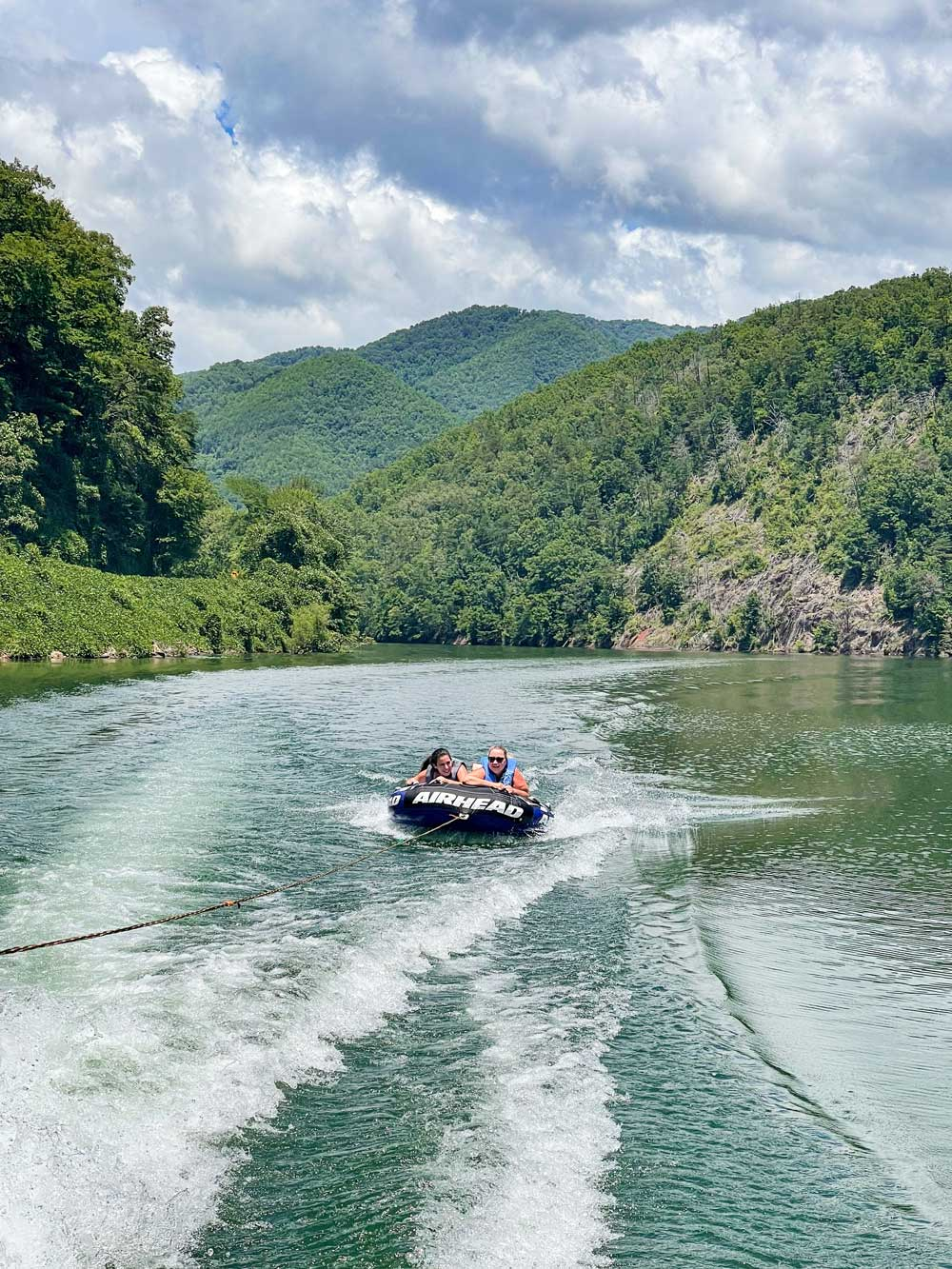 Best Things to Do in Bryson City NC with Kids - Boating on Lake Fontana   Things to do in Bryson City NC by popular Florida travel blog, Fresh Mommy Blog: image of a family boating on Lake Fontana.