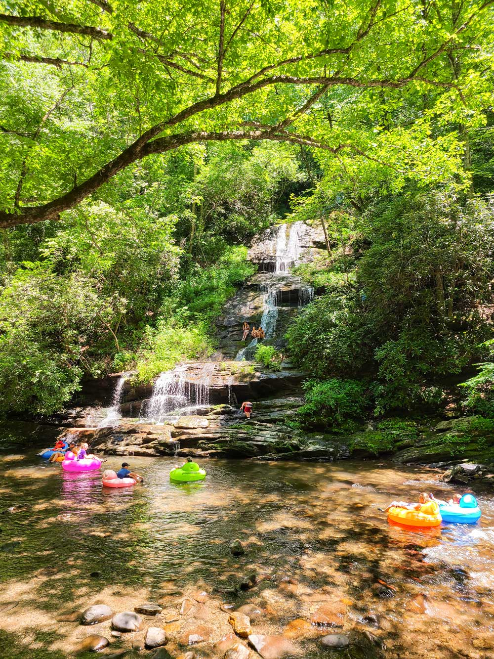 Best Things to Do in Bryson City NC with Kids - Deep Creek River and Tubing   Things to do in Bryson City NC by popular Florida travel blog, Fresh Mommy Blog: image of a family tubing on Deep Creek River.
