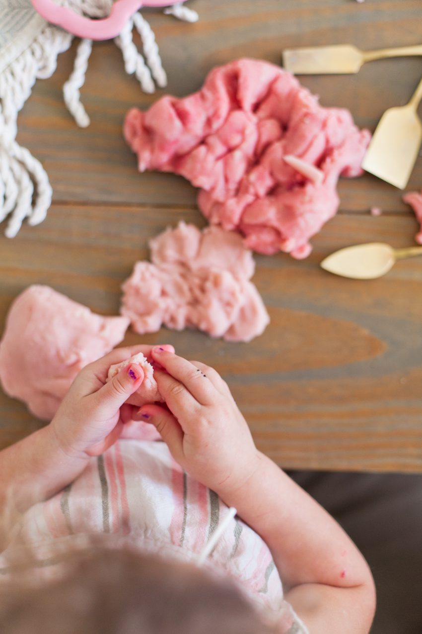 Easy Recipe for The Best Homemade Playdough with Essential Oils for Calming by top Florida lifestyle blogger Tabitha Blue of Fresh Mommy Blog. Change the colors and cookie cutters for any holiday. This pink is perfect for Valentine's Day or Easter!